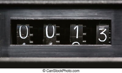old mechanical counter quickly counts numbers - macro