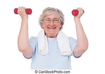 Senior woman lifting hand weights