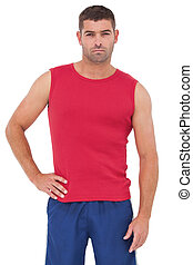 Fit man looking at camera on white background