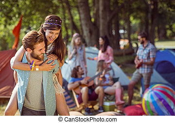 Hipster couple having fun on camps