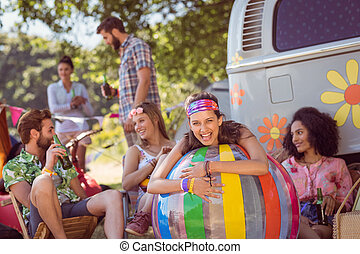 Hipsters having fun on campsite