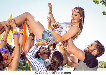 Happy hipster woman crowd surfing - Happy hipster woman...