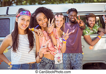 Hipsters hanging out by camper van - Hipsters hanging out by...