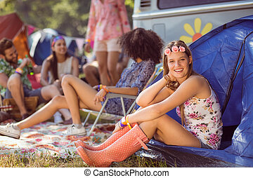 Carefree hipster smiling on campsite
