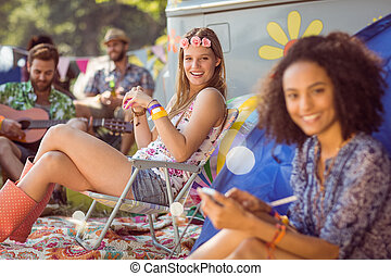 Hipsters relaxing on campsite - Carefree hipster relaxing on...