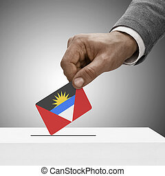 Black male holding flag. Voting concept - Antigua and...