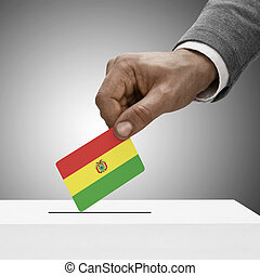 Black male holding flag Voting concept - Bolivia