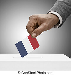 Black male holding flag. Voting concept - France