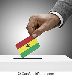 Black male holding flag Voting concept - Ghana