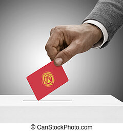 Black male holding flag. Voting concept - Kyrgyzstan
