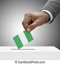 Black male holding flag Voting concept - Nigeria