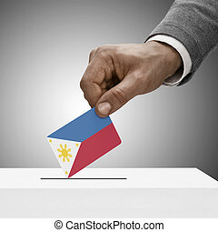 Black male holding flag. Voting concept - Philippines