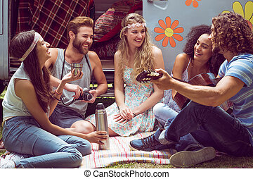 Friends by camper van at festival - Hipster friends by...