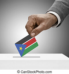 Black male holding flag Voting concept - South Sudan