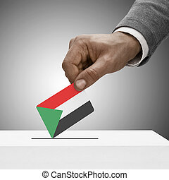 Black male holding flag Voting concept - Sudan