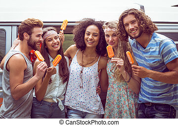 Hipster friends enjoying ice lollie - Hipster friends...