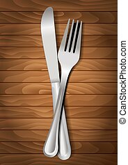 Fork and knife on wooden background for your design