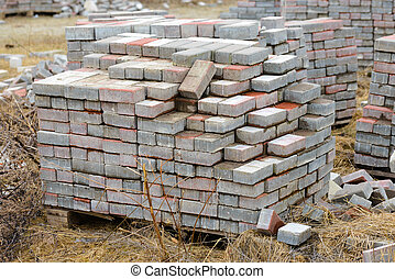 Heap of Bricks - Stack of calcium silicate bricks on a...