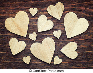 Various sized wooden hearts with a good composition on a...
