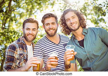 Hipster friends having a beer - Hipster friends having a...