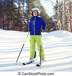 Portrait of professional skier boy dressed in sportswear and...