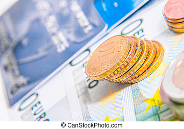 European currency - a tower of Euro coins, banknote,...