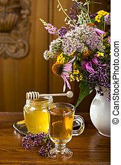 medicinal herbs, honey, herbal tea - Still life from...