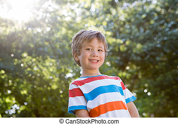 Happy little boy smiling at camera