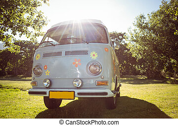 Retro camper van in a field on a summers day