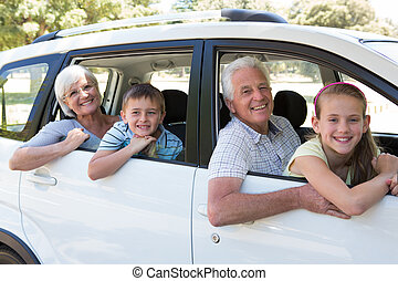 Grandparents going on road trip with grandchildren on a...