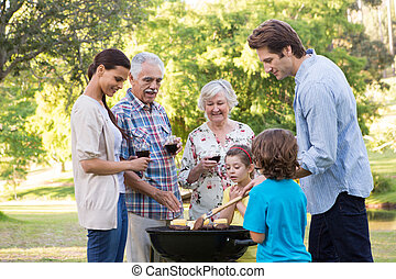 Extended family having a barbecue