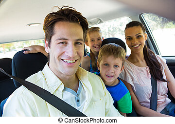Happy family on a road trip