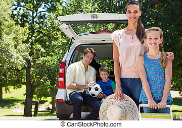 Family getting ready for road trip - Happy family getting...