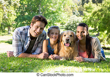 Family with their dog in the park