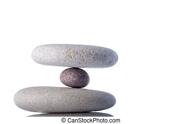 Hanging or floating rocks isolated on white inside studio