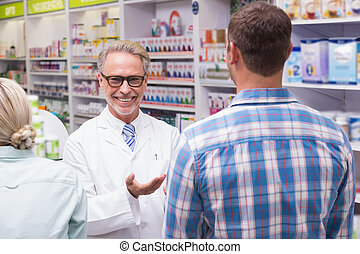 Smiling pharmacist at the pharmacy