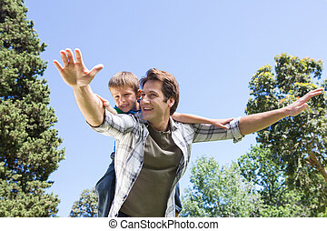 Father and son having fun in the park