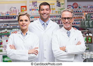 Pharmacists smiling at camera - Team of pharmacists smiling...