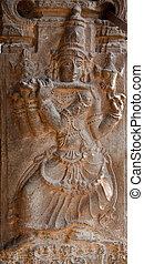 Bas relief in ancient Hindu temple depicting Krishna