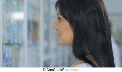 Young girl consults in a drugstore - Young girl consults in...