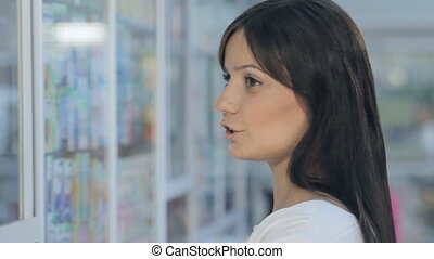 Young beautiful girl in drugstore - Young beautiful girl in...