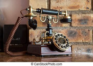 antique analog telephone - An antique analog telephone set...