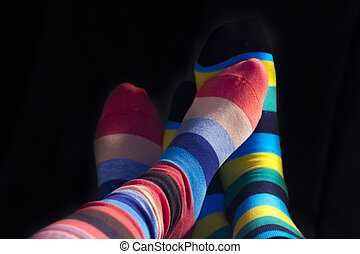 Colored socks on couple feets