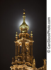 Tower of Hofkirche on the moonlight background in Dresden,...