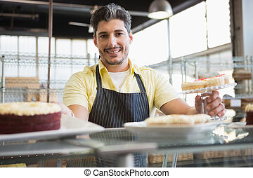Attractive worker in apron posing - Attractive worker in...