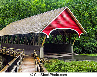 The Flume Covered Bridge is a Paddleford truss design...