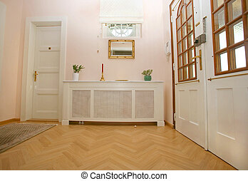 entrance hall to house with radiator heater cover as...