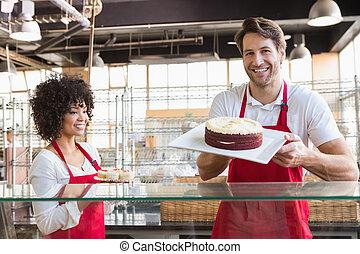 sonriente, colegas, en, uniforme, actuación, cakes, ,...