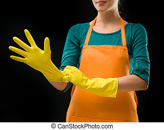 cleaning lady putting on rubber gloves - cleaning woman...