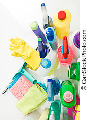 cleaning - top view of cleaning supplies on white table